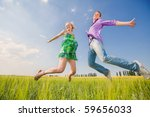 happy people is jumping in field | Shutterstock . vector #59656033