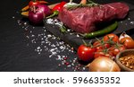 raw meat. raw beef steak on a... | Shutterstock . vector #596635352