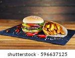 tasty and appetizing hamburger... | Shutterstock . vector #596637125