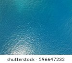 aerial view of the blue ocean... | Shutterstock . vector #596647232