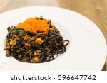 white plate of black spaghetti... | Shutterstock . vector #596647742