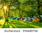 tents camping area  early... | Shutterstock . vector #596680706