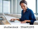 focused young businesswoman... | Shutterstock . vector #596691095