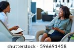 two focused young business... | Shutterstock . vector #596691458