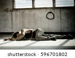 female laying dead on the... | Shutterstock . vector #596701802