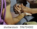 henna painting for tourist on a ... | Shutterstock . vector #596724302