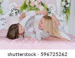 mom with her teen daughter... | Shutterstock . vector #596725262