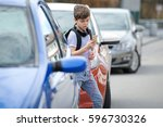 young caucasian boy is busy... | Shutterstock . vector #596730326