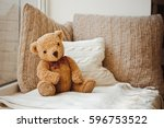 a beautiful soft toy bear sits... | Shutterstock . vector #596753522