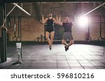 sporty people doing chin ups.... | Shutterstock . vector #596810216