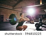 young muscular woman in...   Shutterstock . vector #596810225