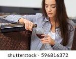 Depressed Woman Drinking Wine...