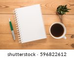 office table with cup of coffee  | Shutterstock . vector #596822612