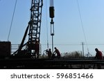 oil field oil workers at work | Shutterstock . vector #596851466