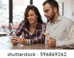 showing him a picture of new...   Shutterstock . vector #596869262