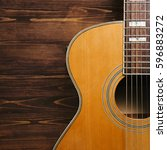 Small photo of Acoustic guitar on a wooden surface. Square image