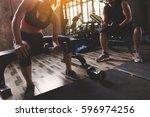 fitness people doing exercises... | Shutterstock . vector #596974256