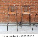 Vintage Chair Against Brick...