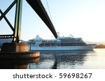 Cruise Ship Passing Under Lion...
