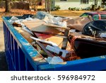 container over flowing... | Shutterstock . vector #596984972