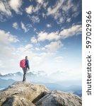 tourist on mountain peak. sport ...   Shutterstock . vector #597029366