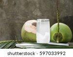coconut juice drink coconut... | Shutterstock . vector #597033992