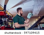 bartender  barista working...   Shutterstock . vector #597109415
