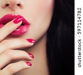pink female lips and manicure... | Shutterstock . vector #597114782