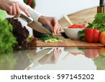 closeup of human hands cooking... | Shutterstock . vector #597145202