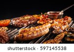 Barbecuing An Assortment Of...