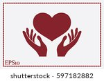 heart in the hands vector icon. | Shutterstock .eps vector #597182882