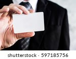 close up of businessman holding ... | Shutterstock . vector #597185756