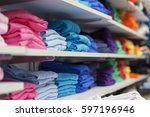 folded tshirts in a shop | Shutterstock . vector #597196946