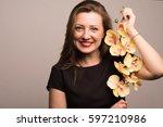 brunette smiling holding... | Shutterstock . vector #597210986
