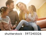 happy family at home spending... | Shutterstock . vector #597240326