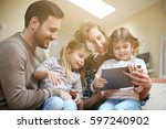 happy family spending time at... | Shutterstock . vector #597240902