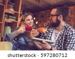 two people sitting in a cafe ... | Shutterstock . vector #597280712