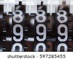 counter numbers closeup  three... | Shutterstock . vector #597285455