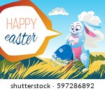 easter rabbit with an egg is on ... | Shutterstock .eps vector #597286892