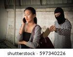 thief stealing wallet from... | Shutterstock . vector #597340226