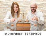 couple holding bricks... | Shutterstock . vector #597384608