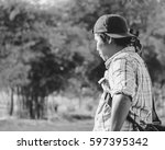 young photographer  waiting for ... | Shutterstock . vector #597395342