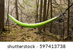 a hammock hanging in the woods... | Shutterstock . vector #597413738