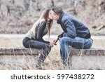 young couple in love holding... | Shutterstock . vector #597438272