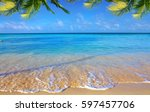 caribbean sea and palm leaves. | Shutterstock . vector #597457706