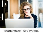 portrait of a young business... | Shutterstock . vector #597490406