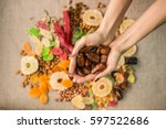 dried dates in hands on a white ... | Shutterstock . vector #597522686