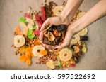 dried dried fruits in hands on... | Shutterstock . vector #597522692
