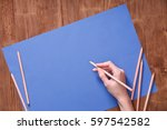 girl hand drawing  blank blue... | Shutterstock . vector #597542582