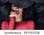 portrait of beautiful african... | Shutterstock . vector #597551528